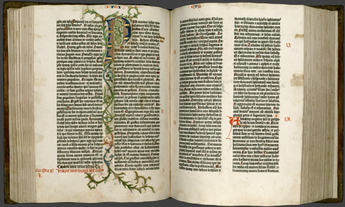 Gutenberg Bible opened to pages 114 verso and 115 recto.